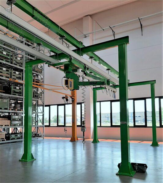 overhead mounted manipulator arm- Articulated arm sliding under overhead rails mounted on a  bridge crane structure